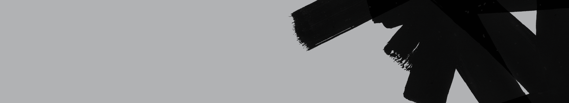 black brush strokes on grey background